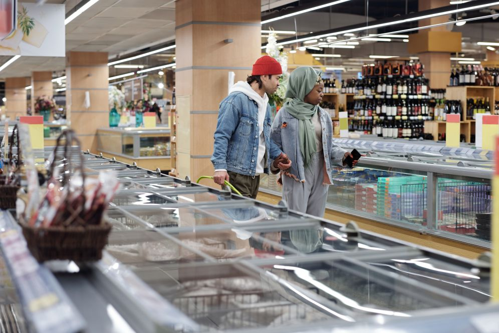 Canva - Couple Shopping at a Supermarket